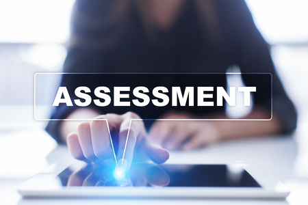 assessments: Woman is using tablet pc, pressing on virtual screen and selecting assessment.
