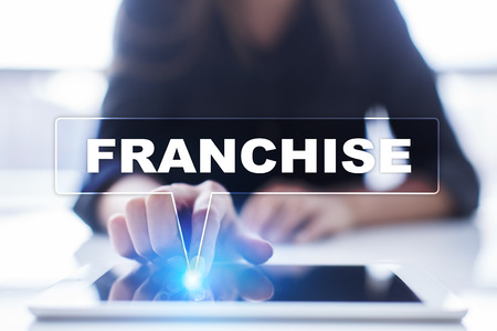 franchising: Woman is using tablet pc, pressing on virtual screen and selecting franchise.