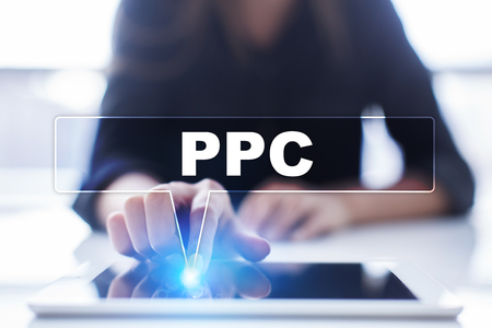 Woman is using tablet pc, pressing on virtual screen and selecting ppc. Stock Photo