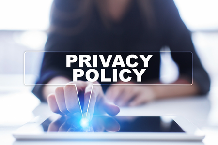Woman is using tablet pc, pressing on virtual screen and selecting privacy policy. Stock Photo