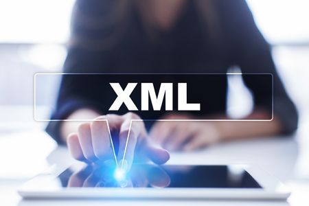 xml: Woman is using tablet pc, pressing on virtual screen and selecting xml.