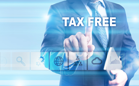 Businessman pressing button on touch screen interface and selecting Tax free.