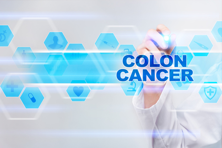 rectal: Medical doctor drawing colon cancer on the virtual screen.