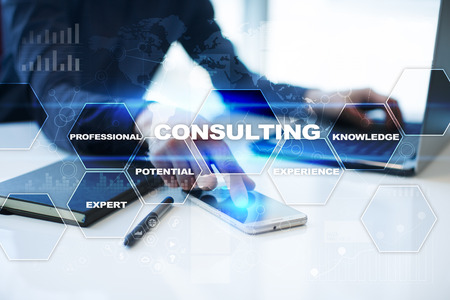 Businessman is working in office, pressing button on virtual screen and selecting consulting. Stockfoto