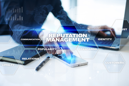 reputable: Businessman is working in office, pressing button on virtual screen and selecting reputation management. Stock Photo