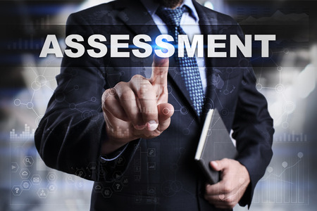 assessments: Businessman is pressing button on touch screen interface and selecting assessment.