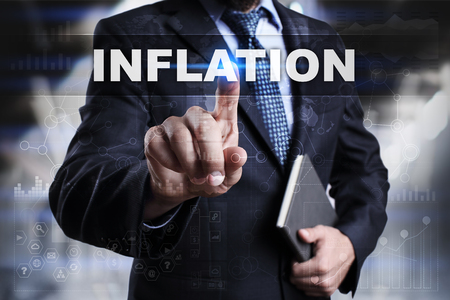 Businessman is pressing button on touch screen interface and selecting inflation.