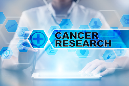 Medical doctor using tablet PC with cancer research medical concept. Stock Photo