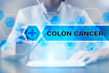 colorectal cancer: Medical doctor using tablet PC with colon cancer medical concept.