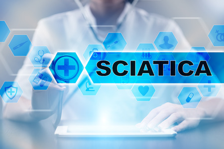 Medical doctor using tablet PC with sciatica medical concept.