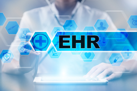 Medical doctor using tablet PC with ehr medical concept.