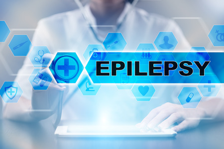 Medical doctor using tablet PC with epilepsy medical concept.