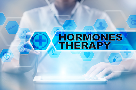 Medical doctor using tablet PC with hormones therapy medical concept. Imagens
