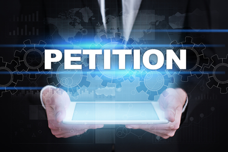 Businessman holding tablet PC with petition concept.