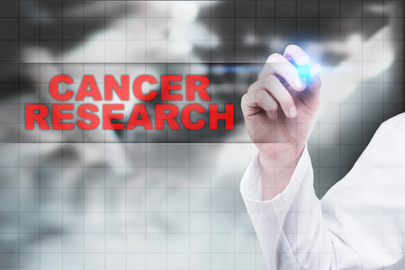 Medical doctor drawing cancer research on virtual screen. Stock Photo