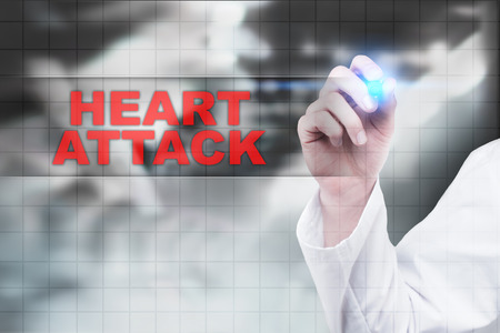 Medical doctor drawing heart attack on virtual screen. Stock Photo