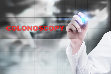 Medical doctor drawing colonoscopy on virtual screen.