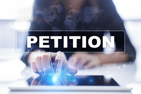 Woman is using tablet pc, pressing on virtual screen and selecting petition