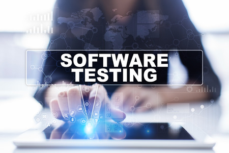 engineering and technology: Woman is using tablet pc, pressing on virtual screen and selecting software testing Stock Photo