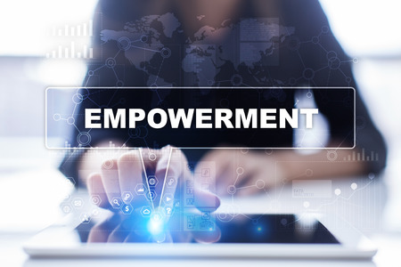 enabling: Woman is using tablet pc, pressing on virtual screen and selecting empowerment