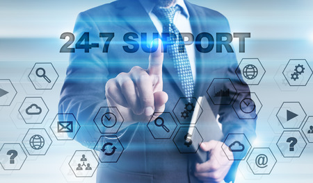 24x7: Businessman pressing button on touch screen interface and selecting 24-7 support.