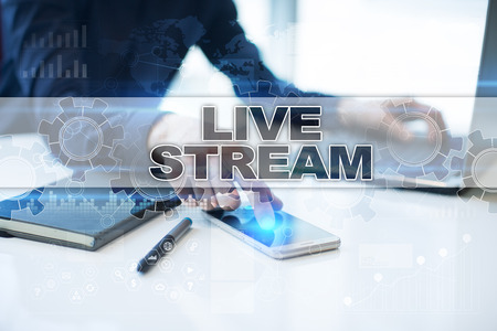 live stream radio: Businessman working in office, pressing button on virtual screen and selecting live stream.