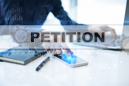 Businessman working in office, pressing button on virtual screen and selecting petition. Stock Photo