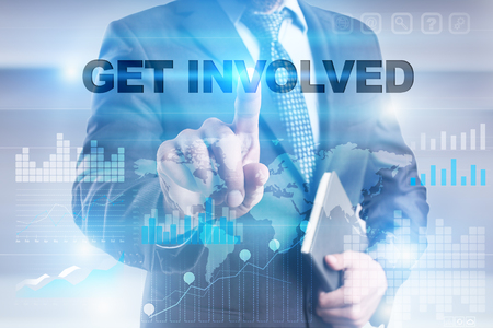 common goal: Businessman pressing button on touch screen interface and selecting get involved. Stock Photo