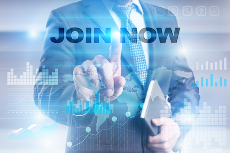 Businessman pressing button on touch screen interface and selecting join now.