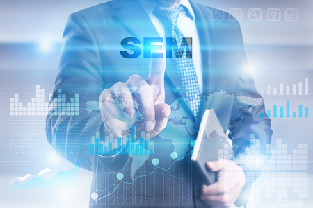Businessman pressing button on touch screen interface and selecting sem. Stock Photo