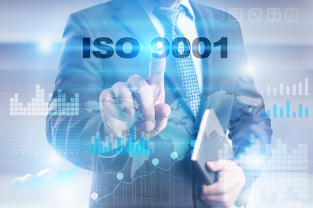 Businessman pressing button on touch screen interface and selecting iso 9001. Stock Photo