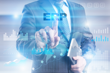 erp: Businessman pressing button on touch screen interface and selecting erp. Stock Photo