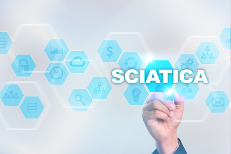 spinal disks: Medical doctor drawing sciatica on the virtual screen.