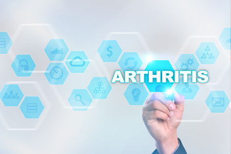 spondylitis: Medical doctor drawing arthritis on the virtual screen.