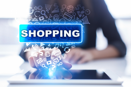 Woman is using tablet pc, pressing on virtual screen and selecting shopping.