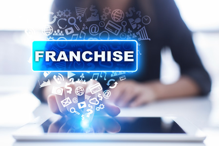 franchises: Woman is using tablet pc, pressing on virtual screen and selecting franchise.