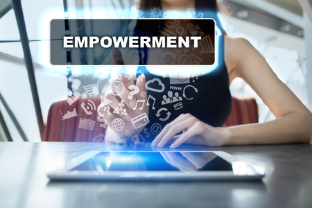enabling: Woman using tablet pc and selecting empowerment.