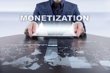 Businessman using tablet pc and selecting monetization.