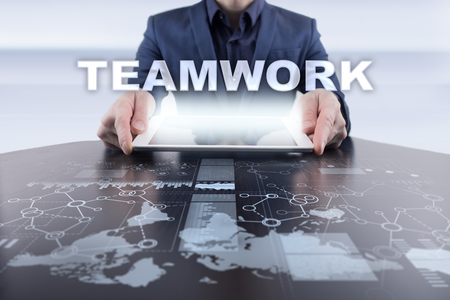 collaborate: Businessman using tablet pc and selecting teamwork.