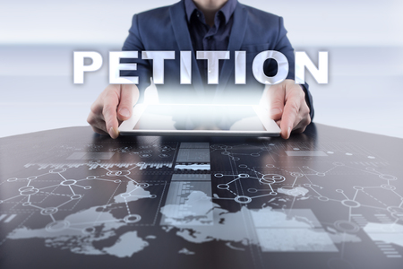 Businessman using tablet pc and selecting petition. Stock Photo