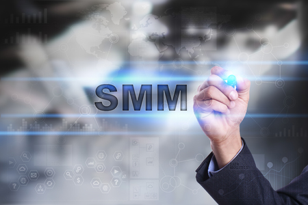 Businessman is drawing on virtual screen. smm concept. Stock Photo