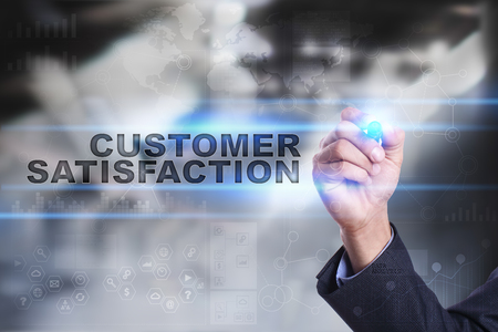 Businessman is drawing on virtual screen. customer satisfaction concept. Stock Photo