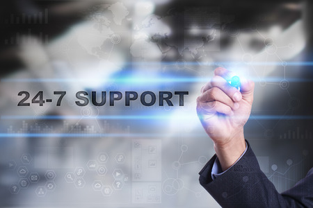 availability: Businessman is drawing on virtual screen. 24-7 support concept.