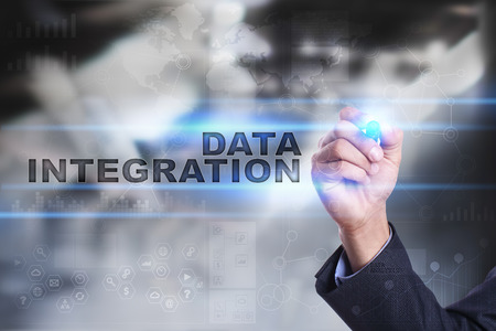 erp: Businessman is drawing on virtual screen. data integration concept. Stock Photo
