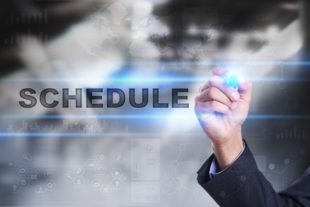 Businessman is drawing on virtual screen. schedule concept. Stock Photo