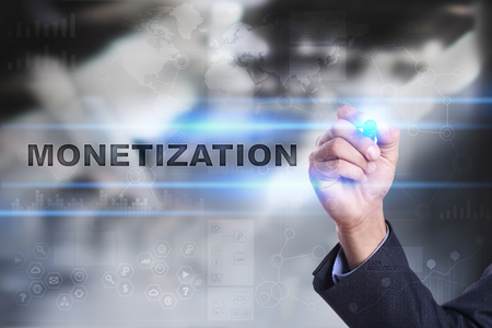 Businessman is drawing on virtual screen. monetization concept.
