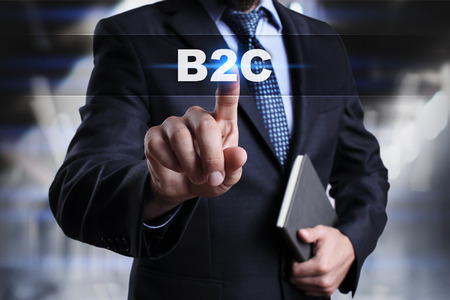 Businessman is pressing button on touch screen interface and selecting b2c.