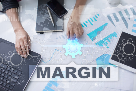 marginal: Woman is working with documents, tablet pc and notebook and selecting margin.