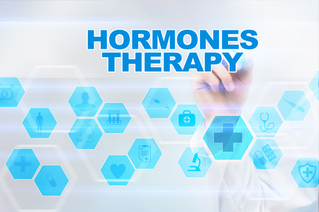 Medical doctor drawing hormones therapy on the virtual screen. Stock Photo