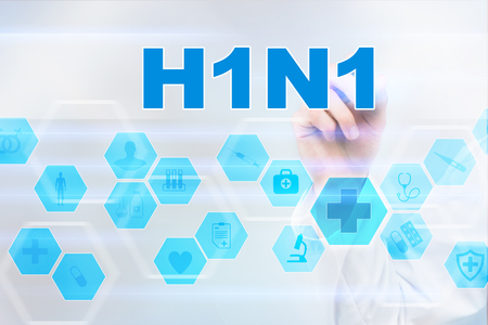 h1n1 vaccinations: Medical doctor drawing h1n1 on the virtual screen.